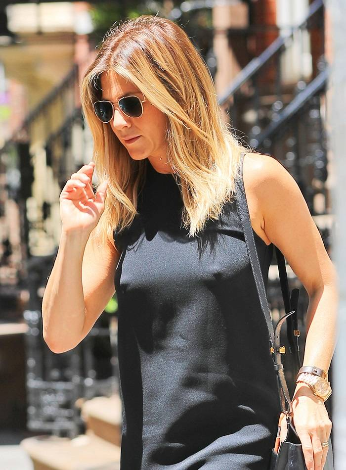 "Jennifer Aniston flashes her ""highbeams"" underneath a sheer black dress when out and about in New York"