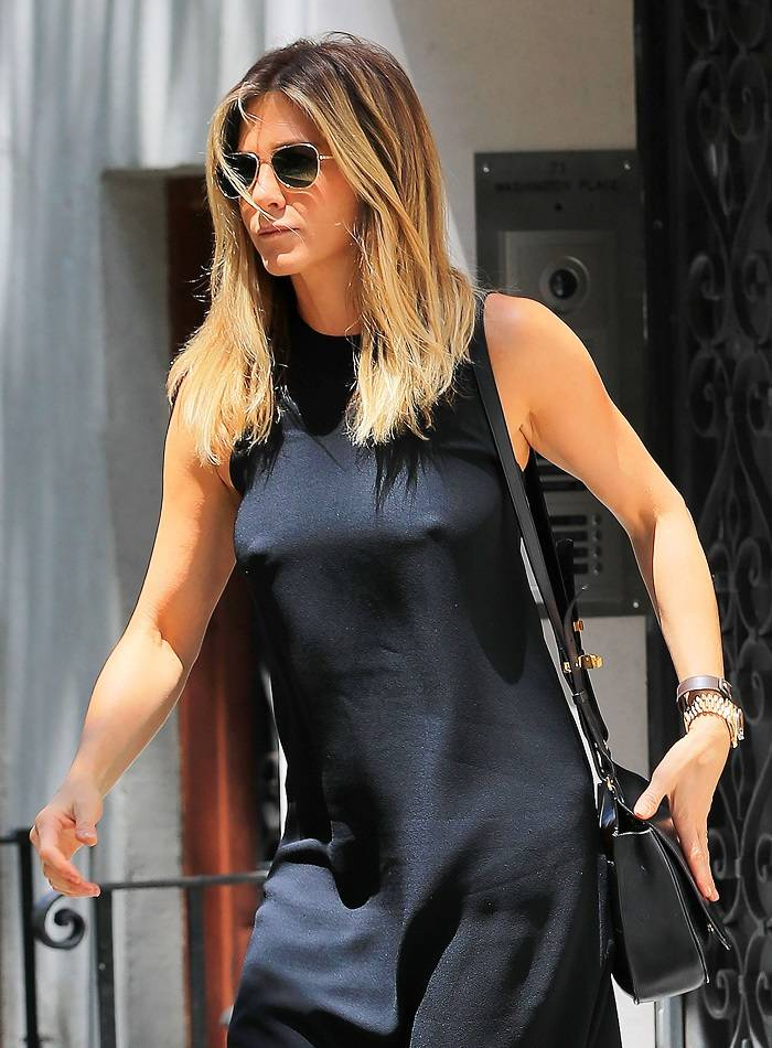 Jennifer Aniston gets nipply under a sheer black dress in sunny New York