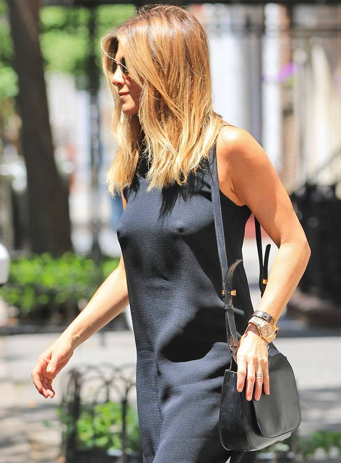 """Jennifer Aniston flashes her """"highbeams"""" underneath a sheer black dress when out and about in New York"""